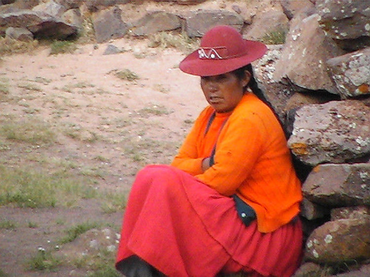 Woman in Orange at Sillustani (image)