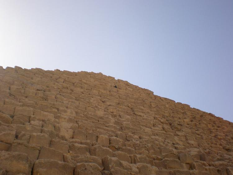 Looking up to the sky from the base of Menkaure pyramid (image)